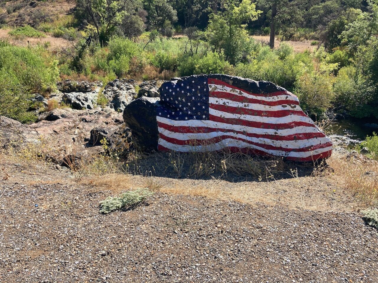 A boulder painted like Old Glory